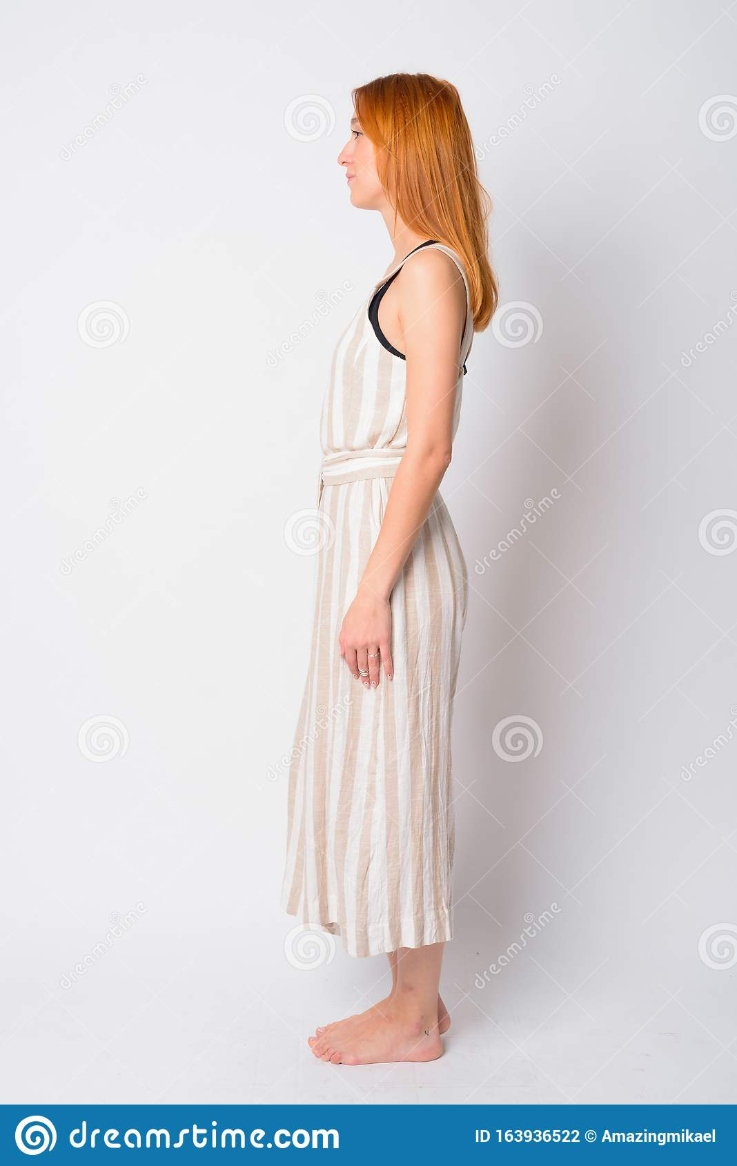 Full Body Shot Profile View Of Young Beautiful Redhead