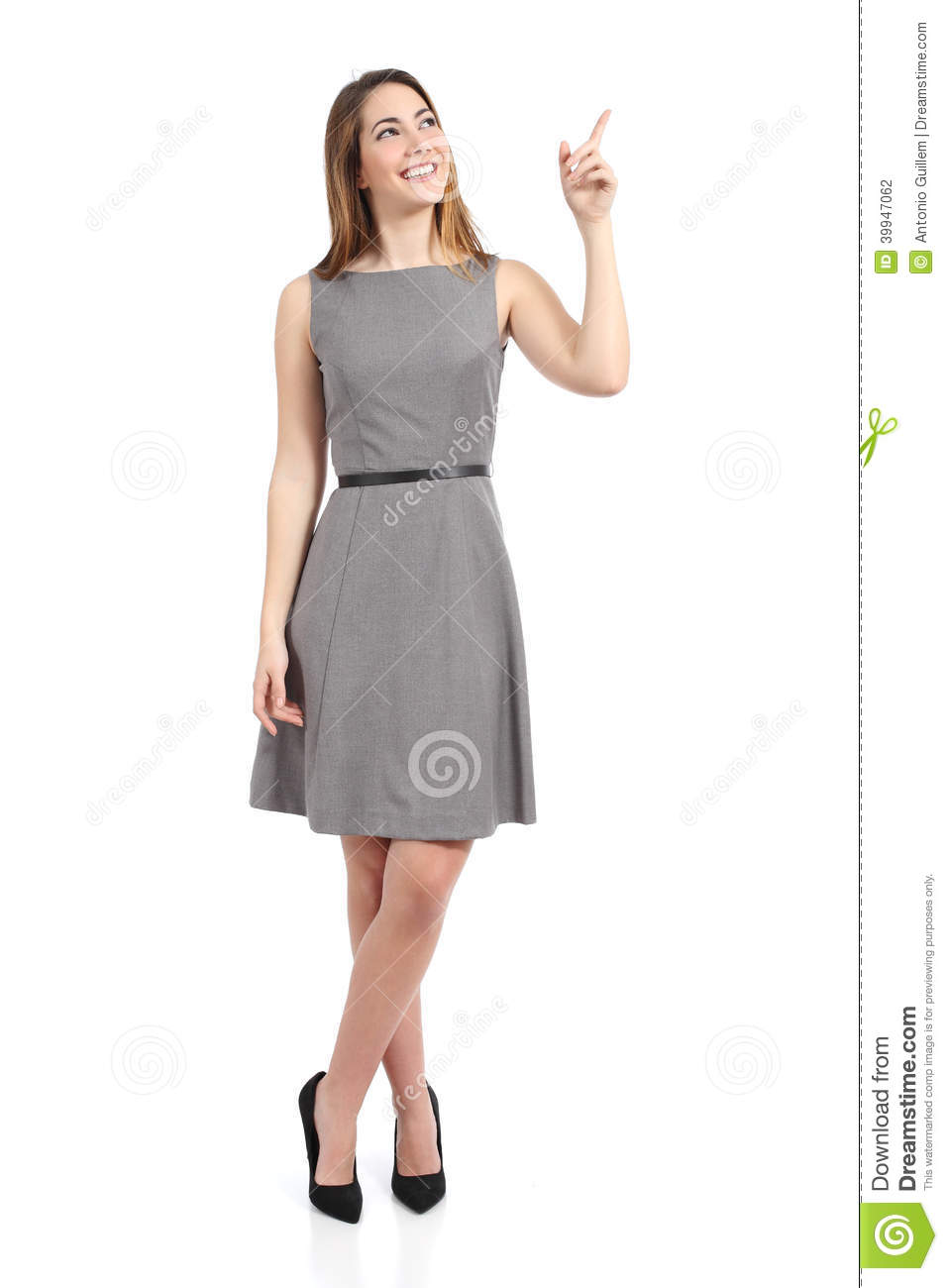 of a standing woman pointing at side isolated on a white backgroundWoman Standing Side White Background