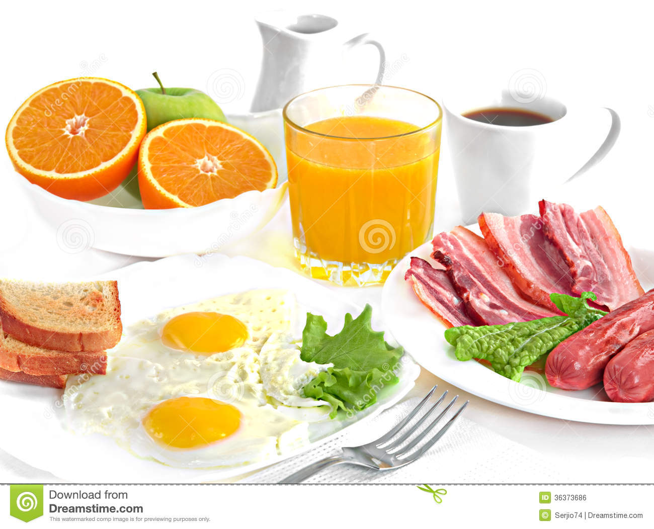 Breakfast - fried eggs, salad, bacon, sausages, bread, cut orange ...
