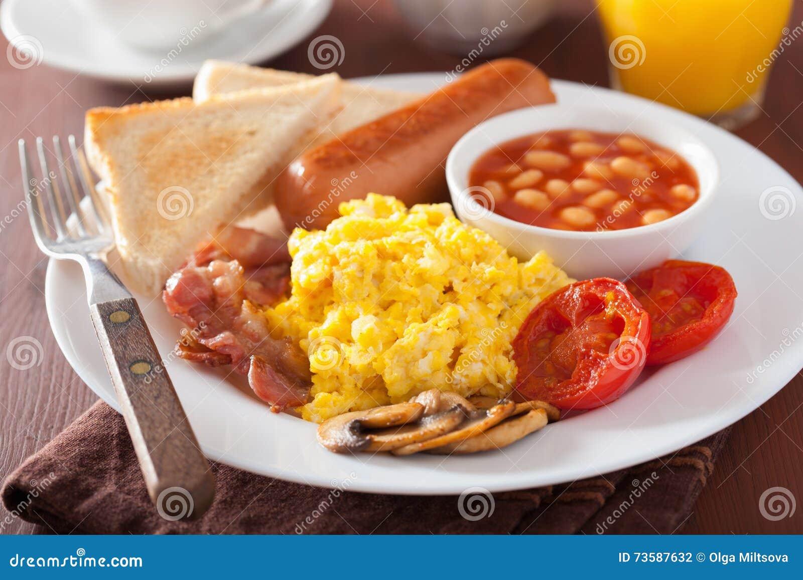 full english breakfast scrambled eggs bacon sausage bean beans tomato 73587632 Orange Coffee Table Heart Shaped Fried Eggs Bread And Orange Juice Stock Photo Image