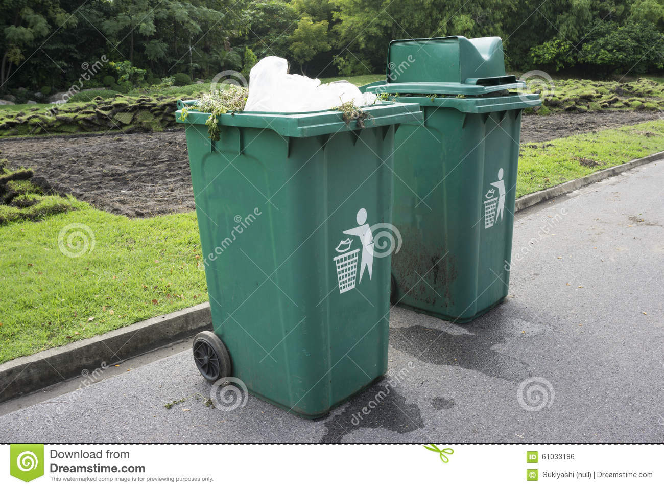 Full green garbage bin on road stock photo image 61033186 - Rd rubbish bin ...