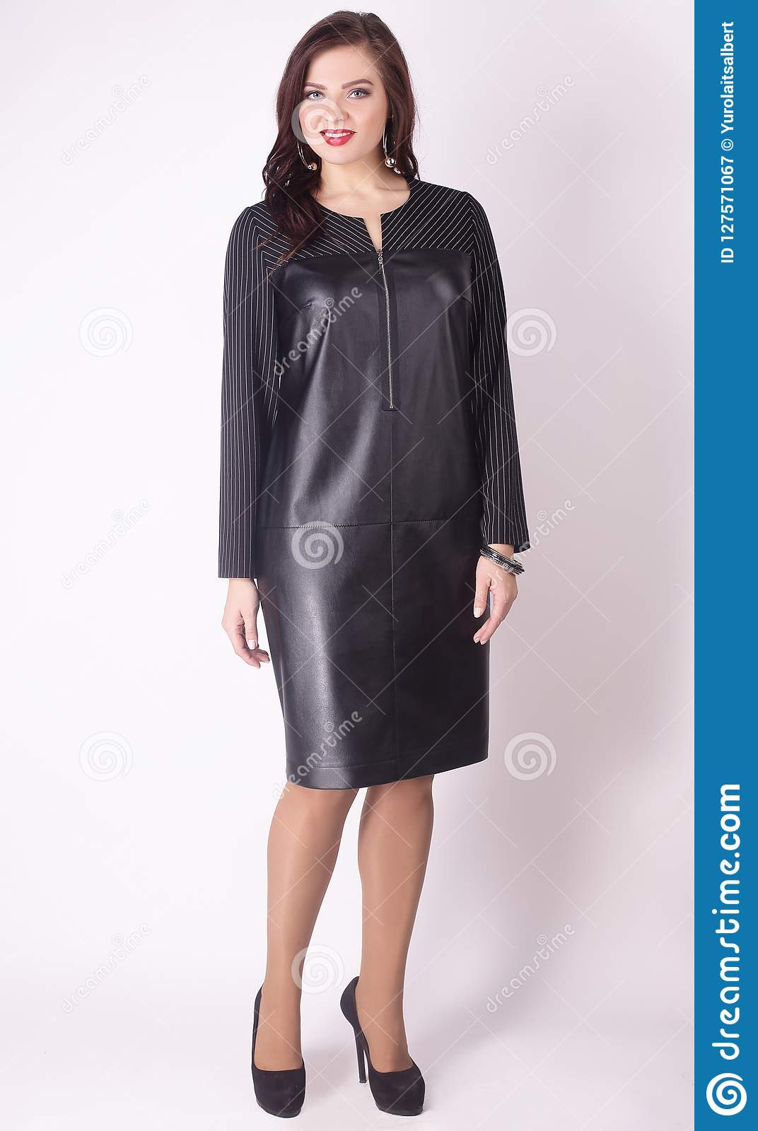 In Full Growth. Modern Woman Model In A Black Leather Dress .plus ...
