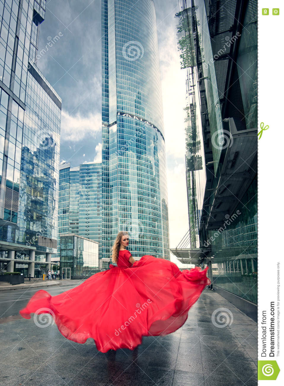 Full growth portrait of fashionable woman on urban background