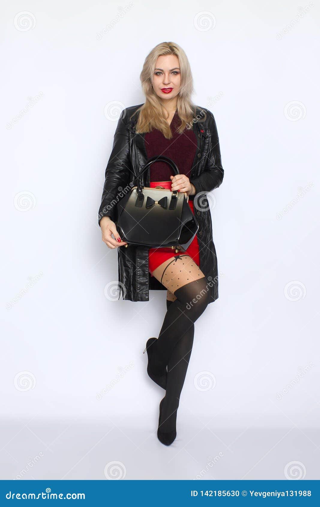 Full length blond holding bag in her hands
