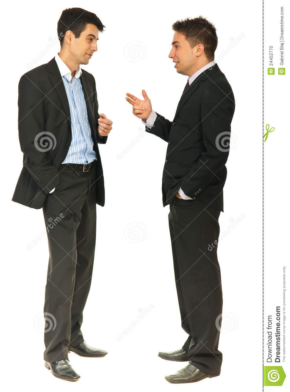 Full length of two business men having conversation together isolated ...