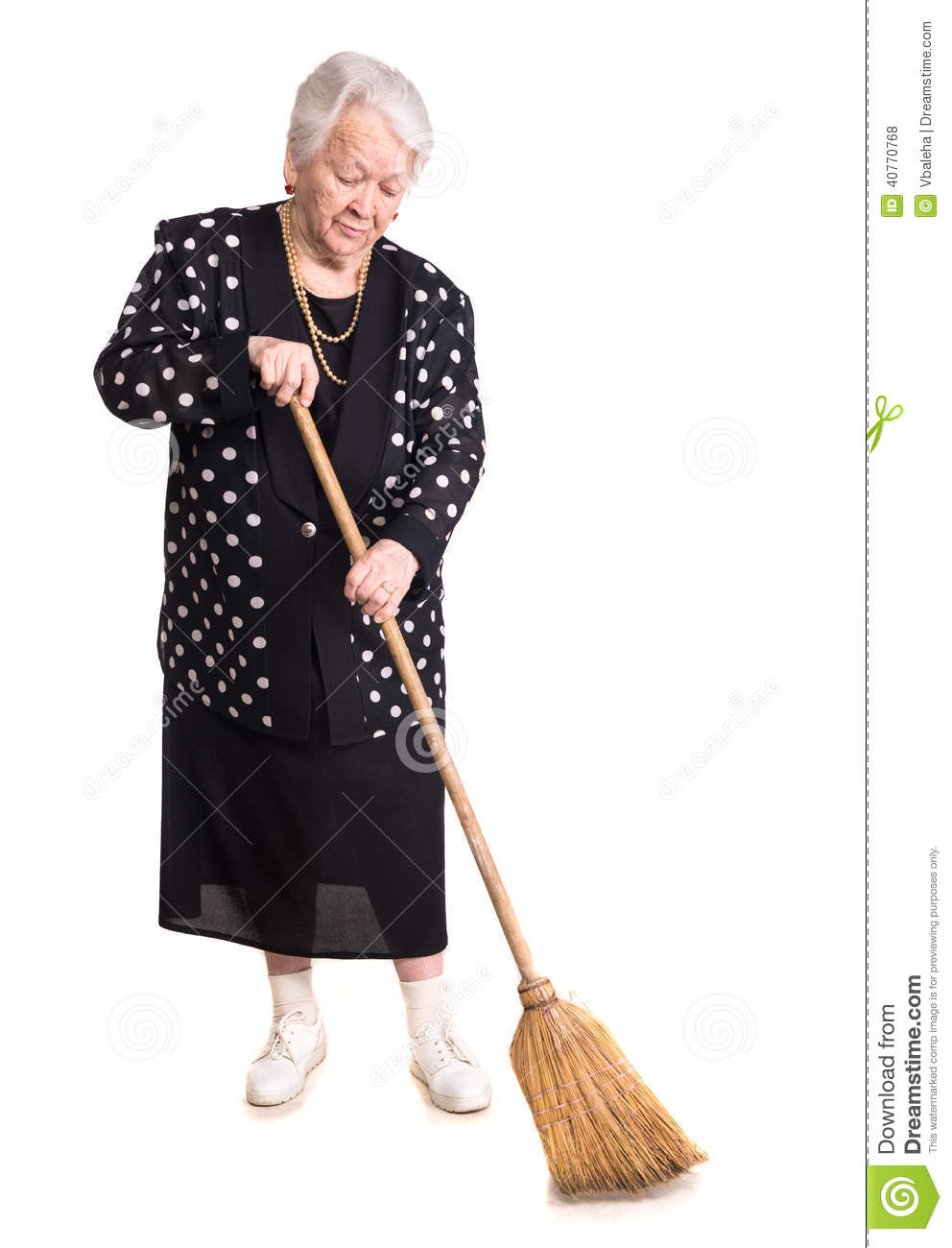 Full Length Of Elderly Woman Cleaning House With Broom