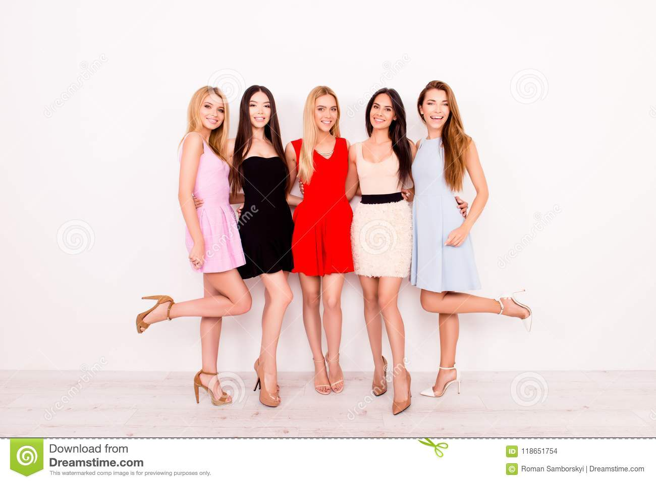 Full Length Of Excited Girlfriends In Colorful Short Cocktail Dresses Are Ready For Birthday Celebration Party Charming And Cute Pretty Elegant