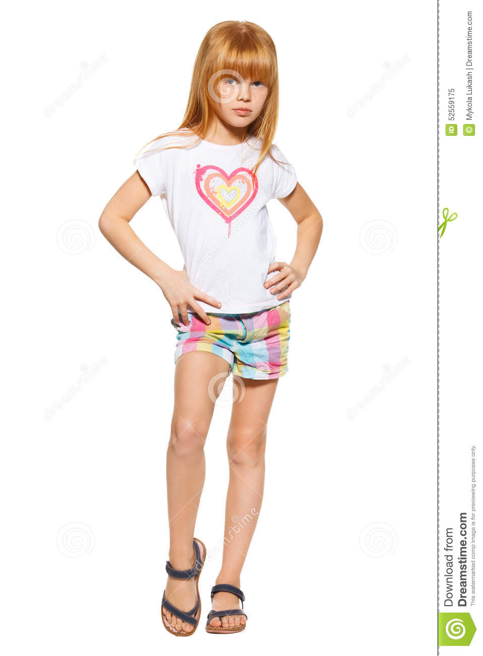 Full Length A Little Girl With Red Hair In Shorts And A T ...