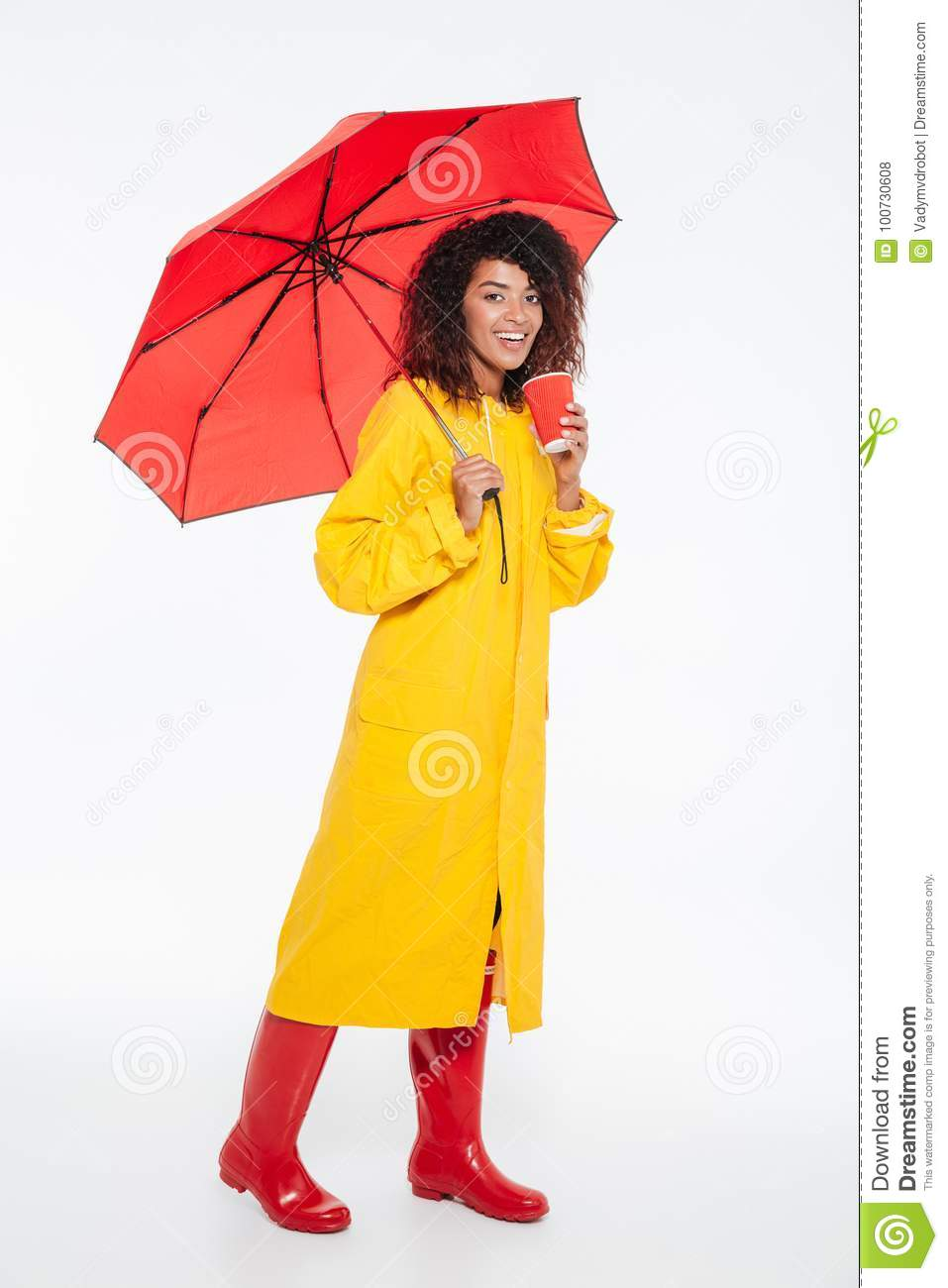 736aaf3c5 Full Length Picture Of Happy African Woman In Raincoat Stock Photo ...
