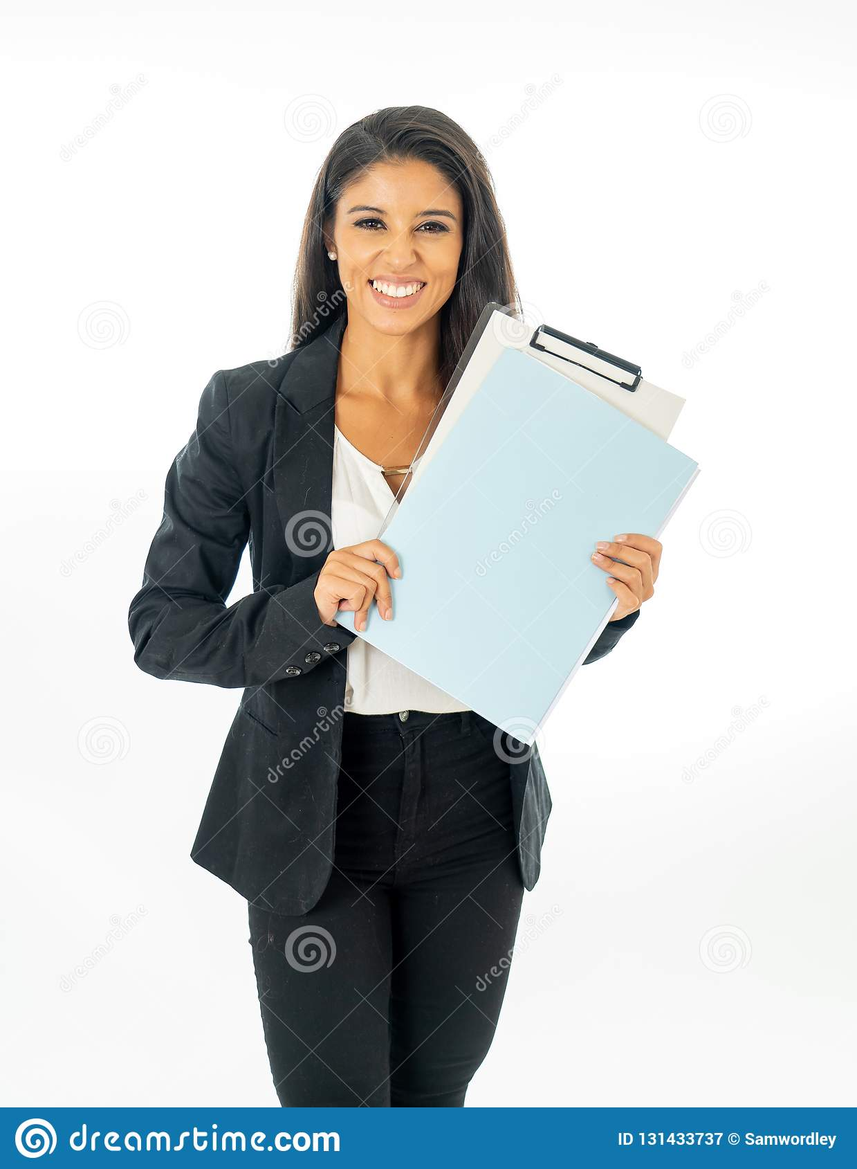 Full length portrait of Attractive latin corporate latin woman looking excited and holding a folder and paperwork in Creative