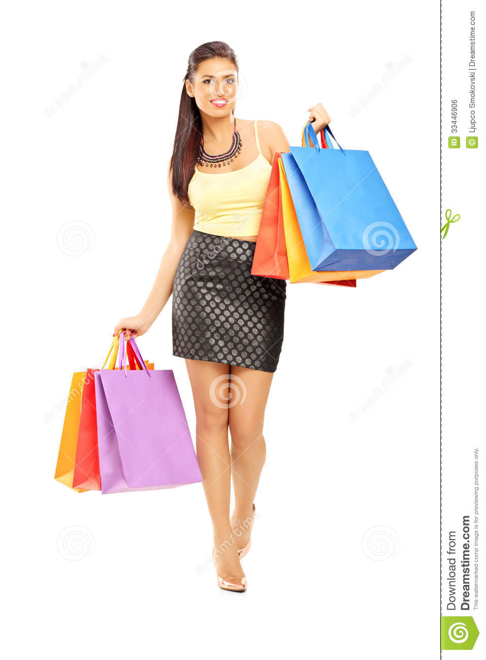 Full Length Portrait Of A Beautiful Woman Walking With Shopping ...