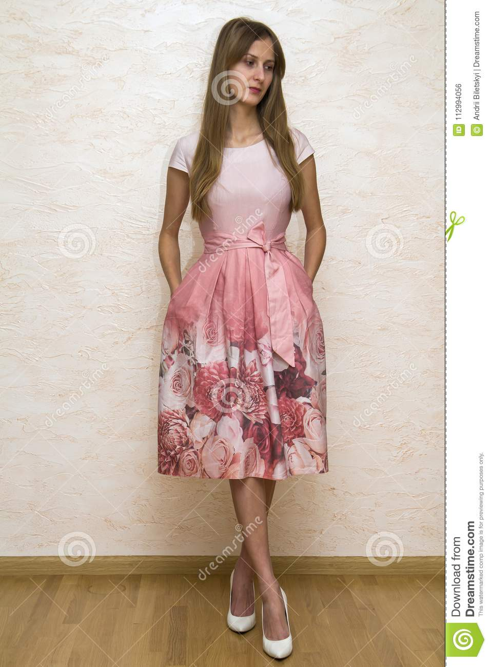 Full Length Portrait Of A Beautiful Young Happy Confident Girl With Long Blond Hair Posing In Summer Dress With Pink Floral Design Stock Photo Image Of Fullbody Female 112994056