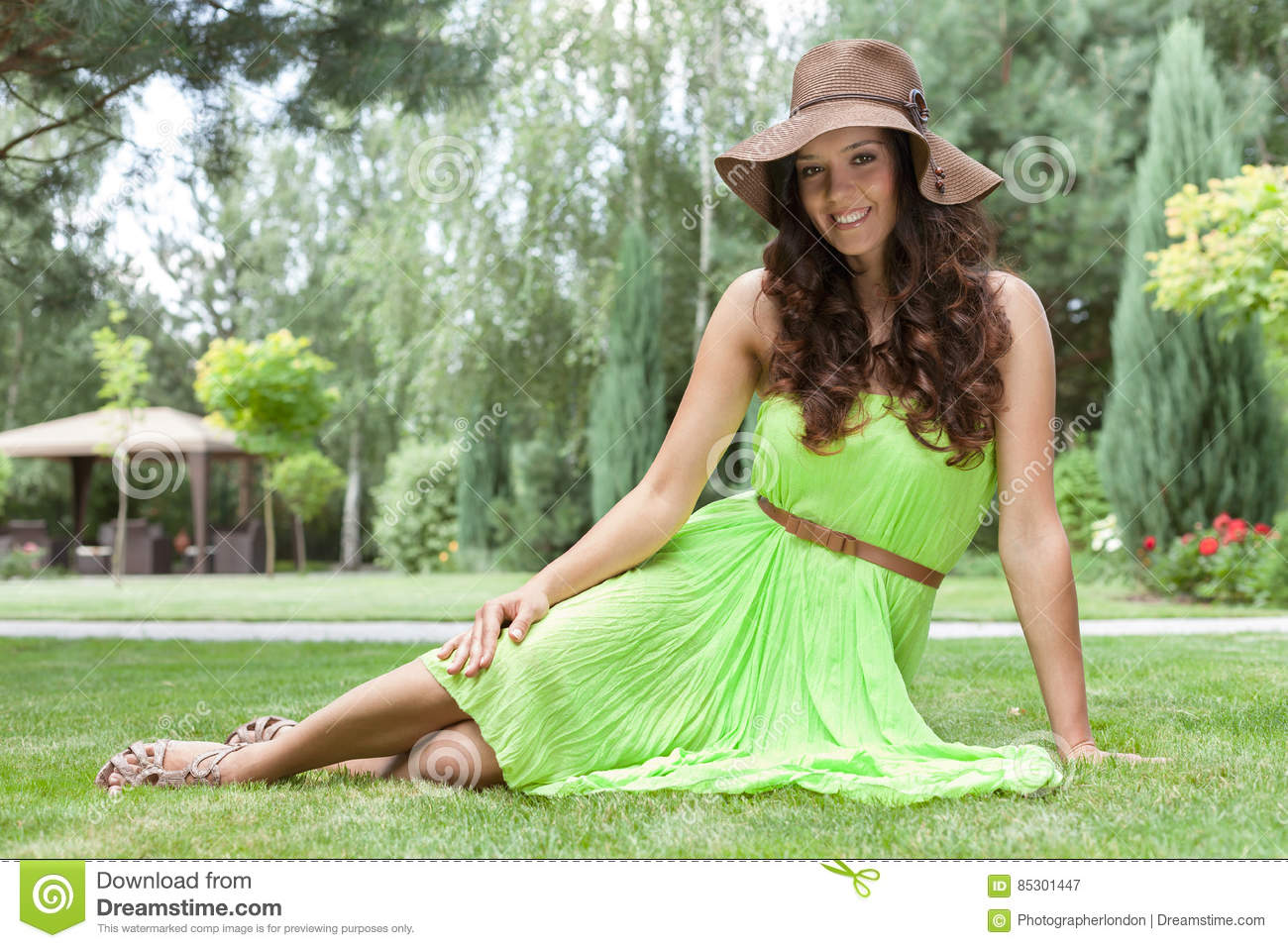 Full length portrait of beautiful young woman in sundress at park