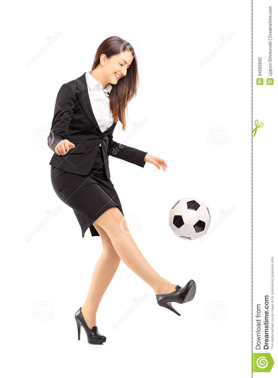 Full length portrait of a businesswoman in high heels kicking a