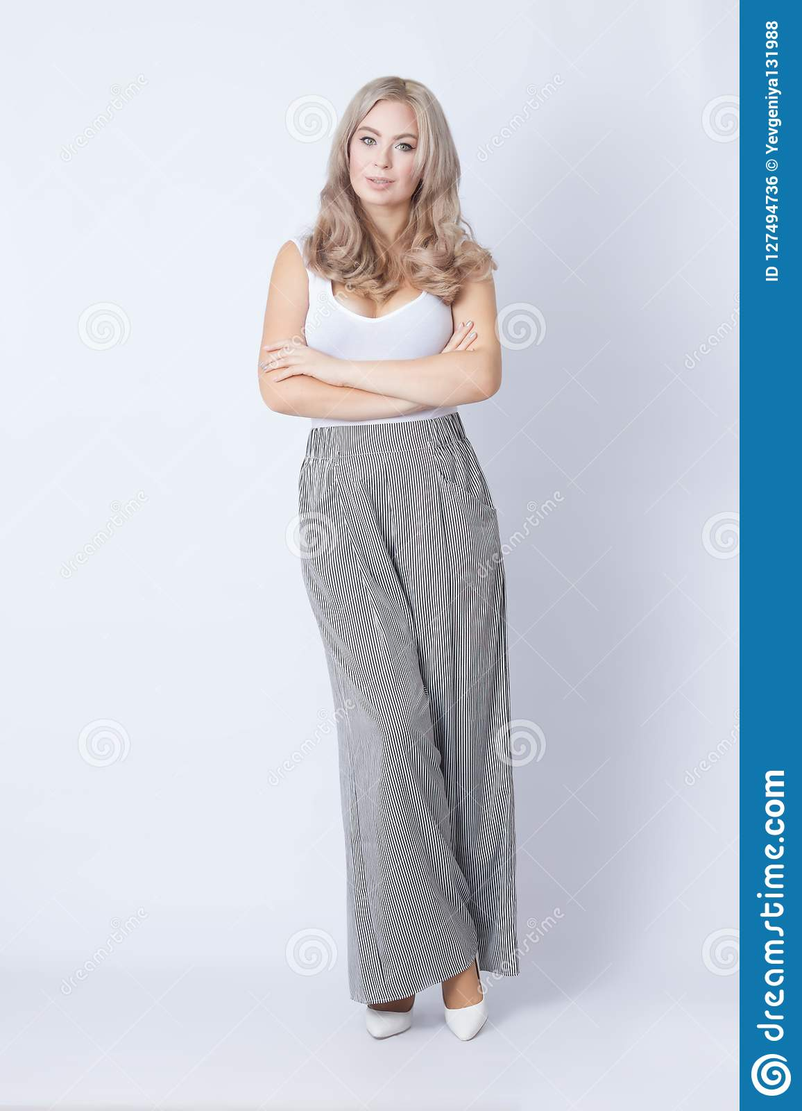 Full length portrait of cheerful blonde woman