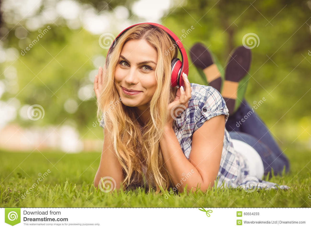 Full length portrait of cheerful woman listening to music