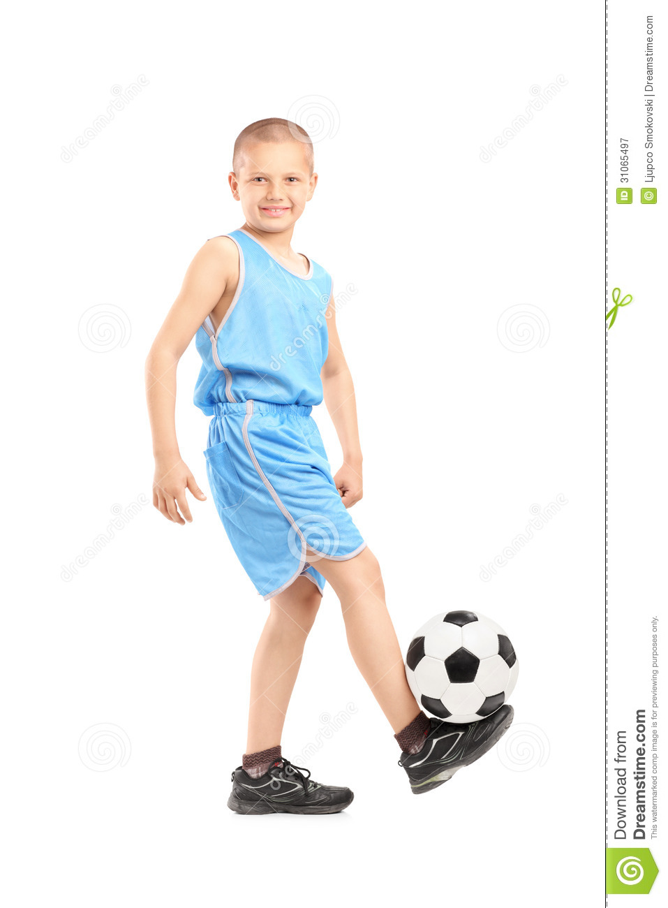 full length portrait of a child playing with a soccer ball