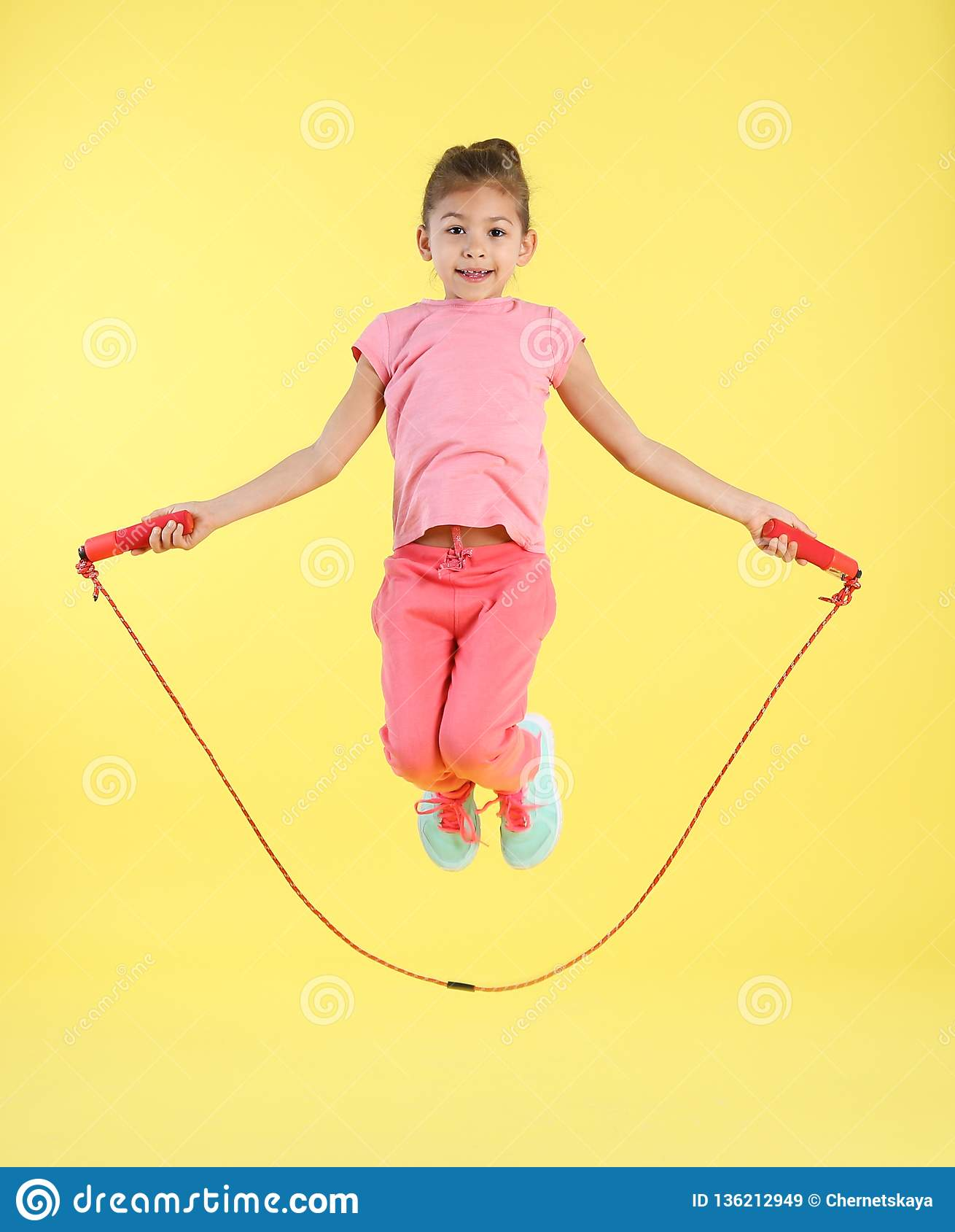 Full length portrait of girl jumping rope