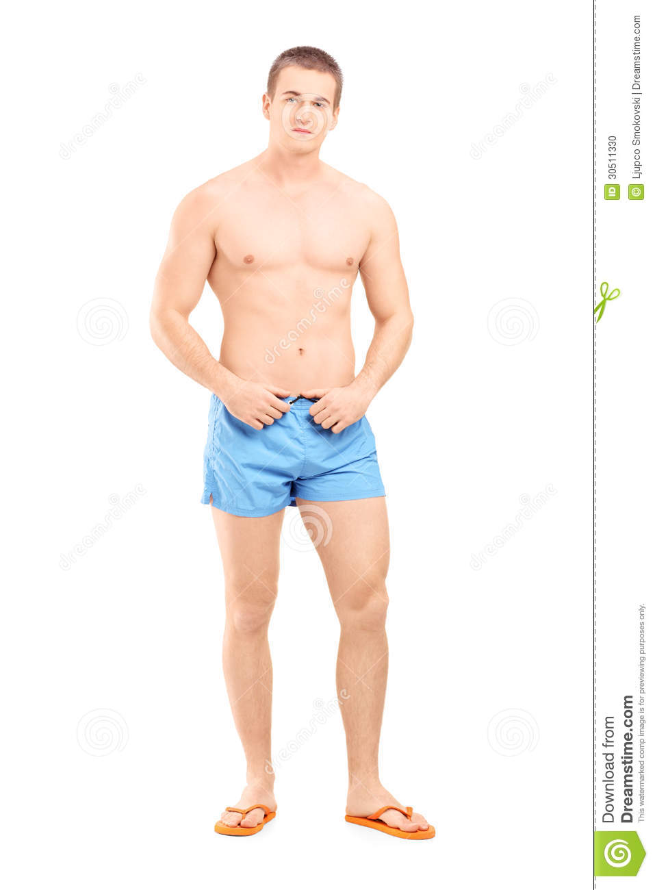 Full length portrait of a handsome muscular man posing in swimsuit