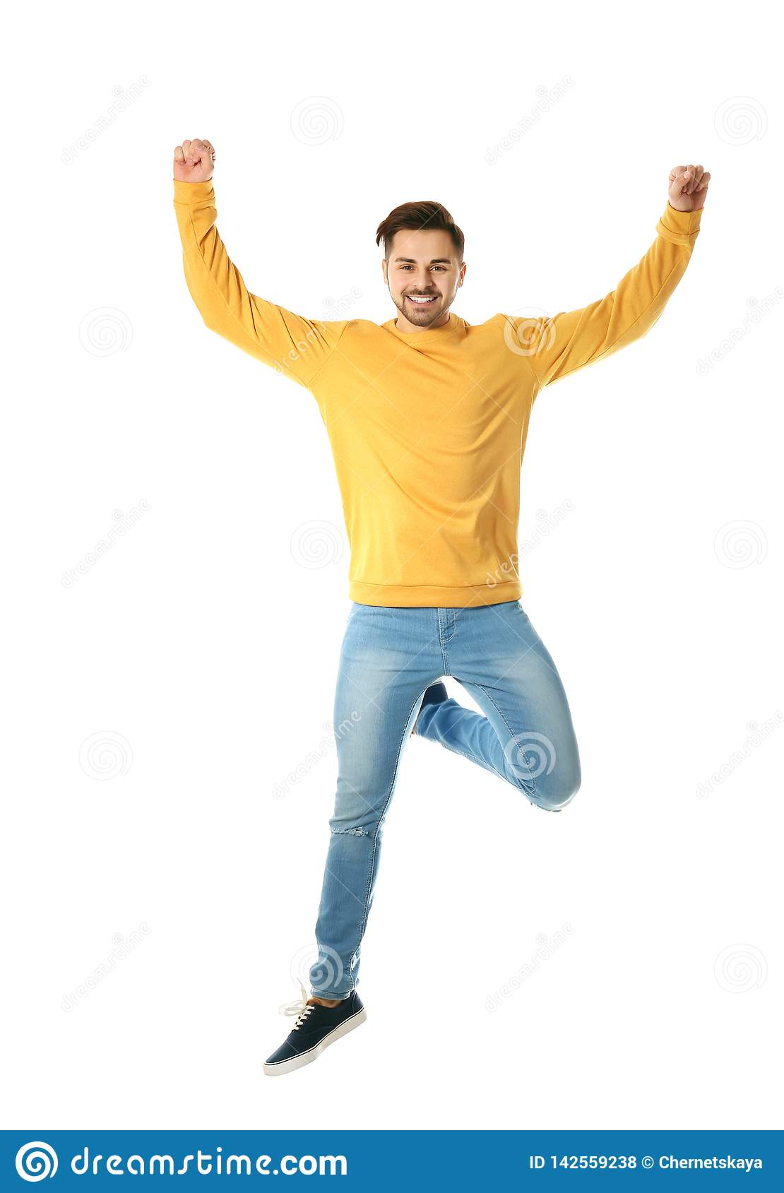Full length portrait of happy handsome man jumping
