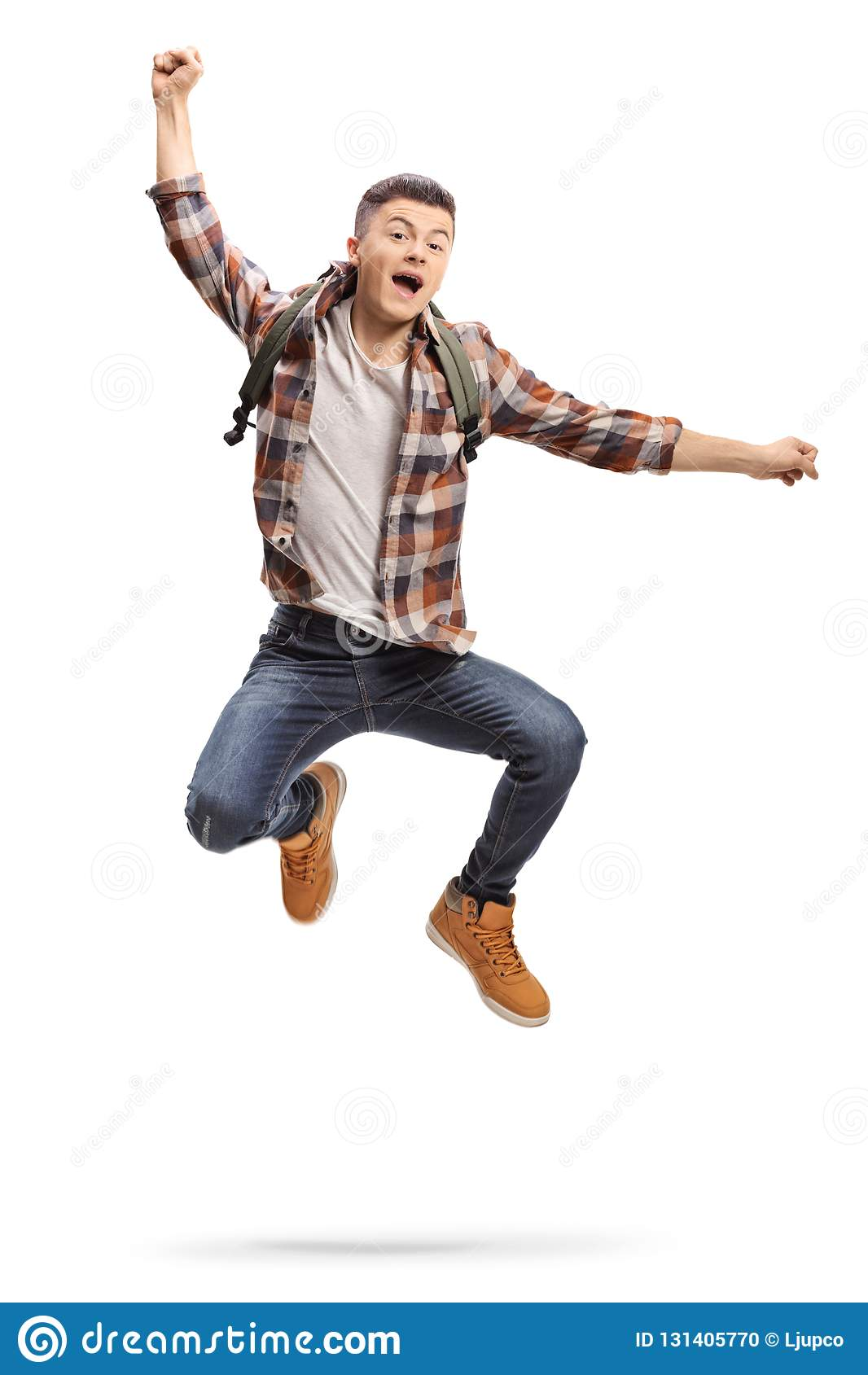 Full length portrait of a joyful teenage student jumping