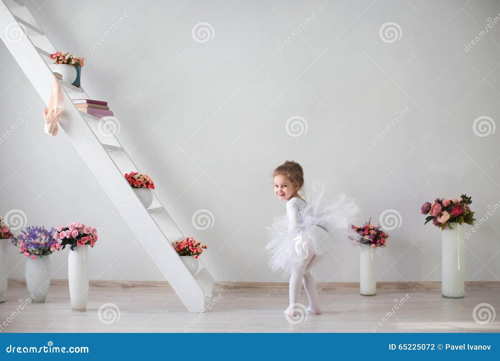 Full length portrait of a little pretty ballerina.
