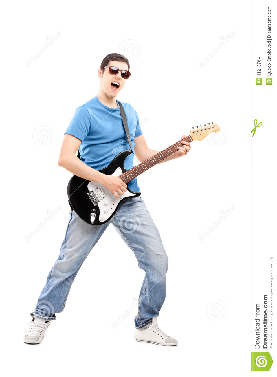 Full Length Portrait Of A Male Musician Playing An