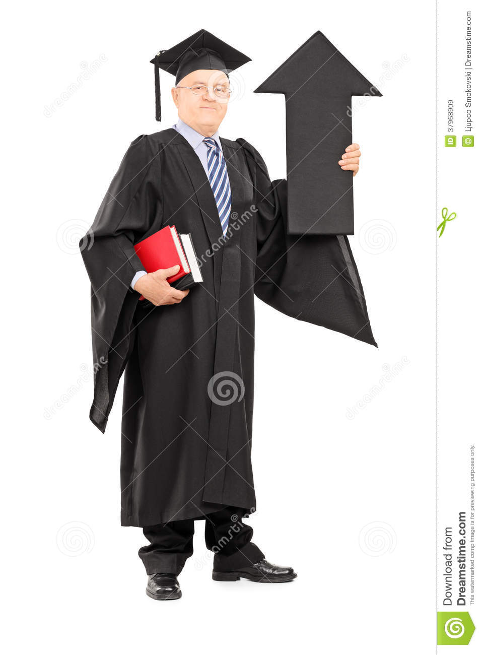 Full Length Portrait Of A Mature Man In Graduation Gown Holding ...