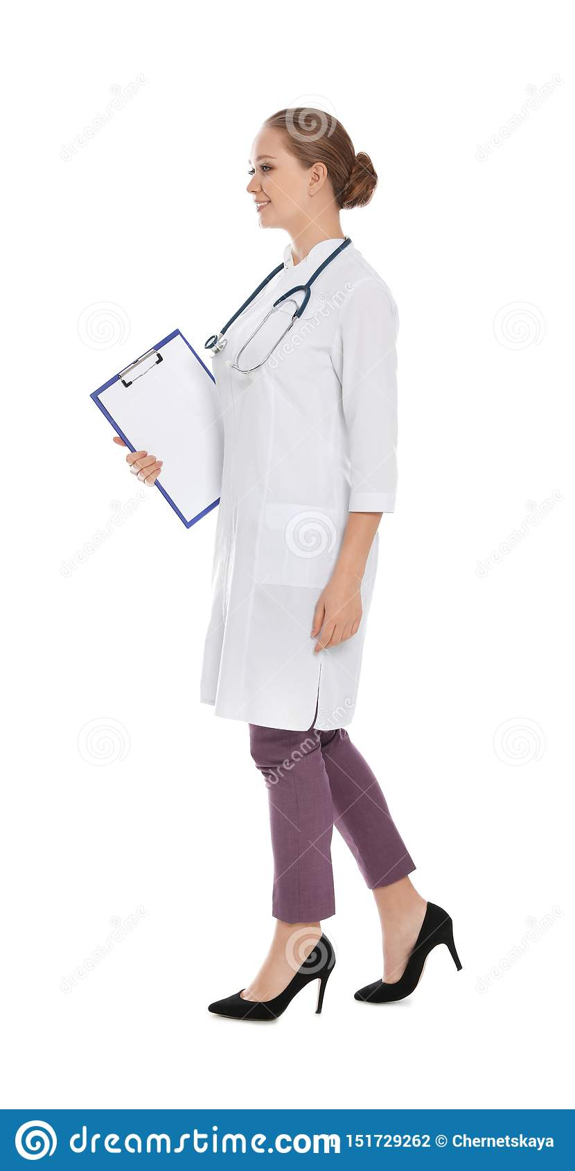 Full length portrait of medical doctor with clipboard and stethoscope isolated