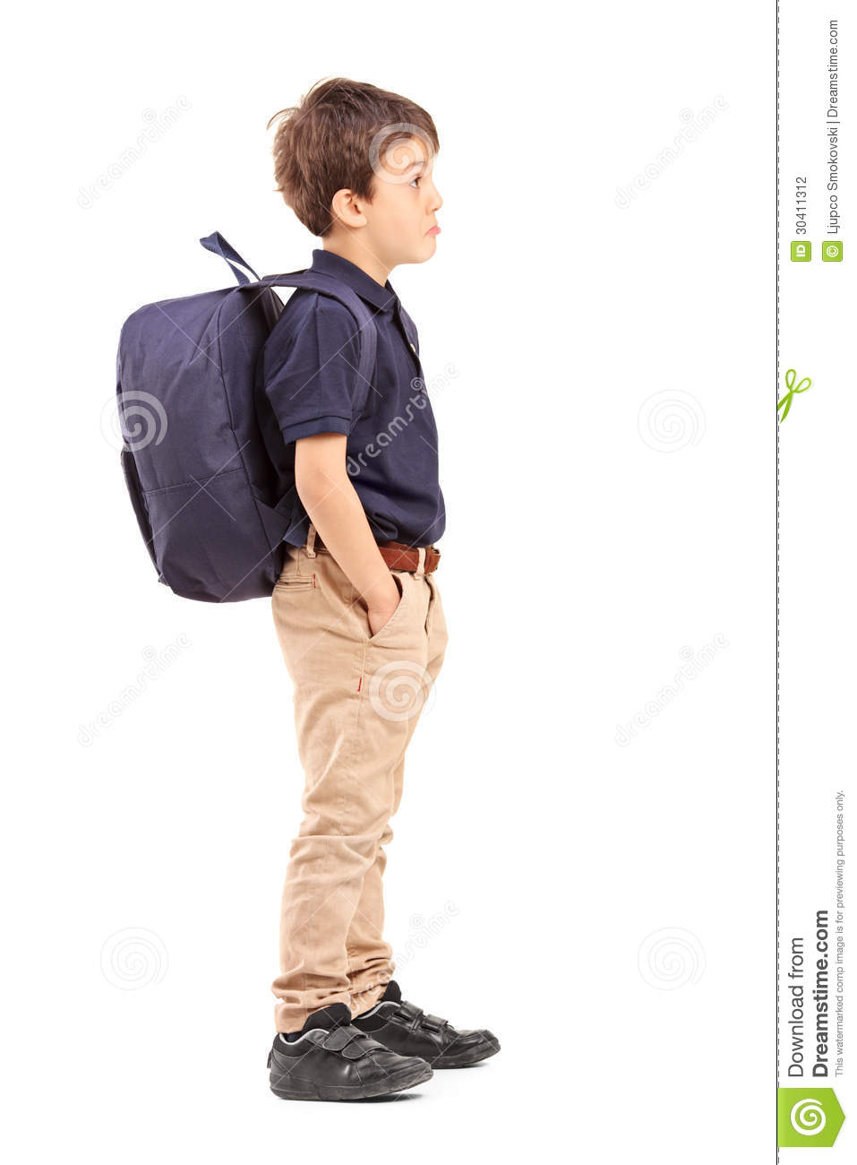 ... of a school boy with backpack standing, isolated on white background