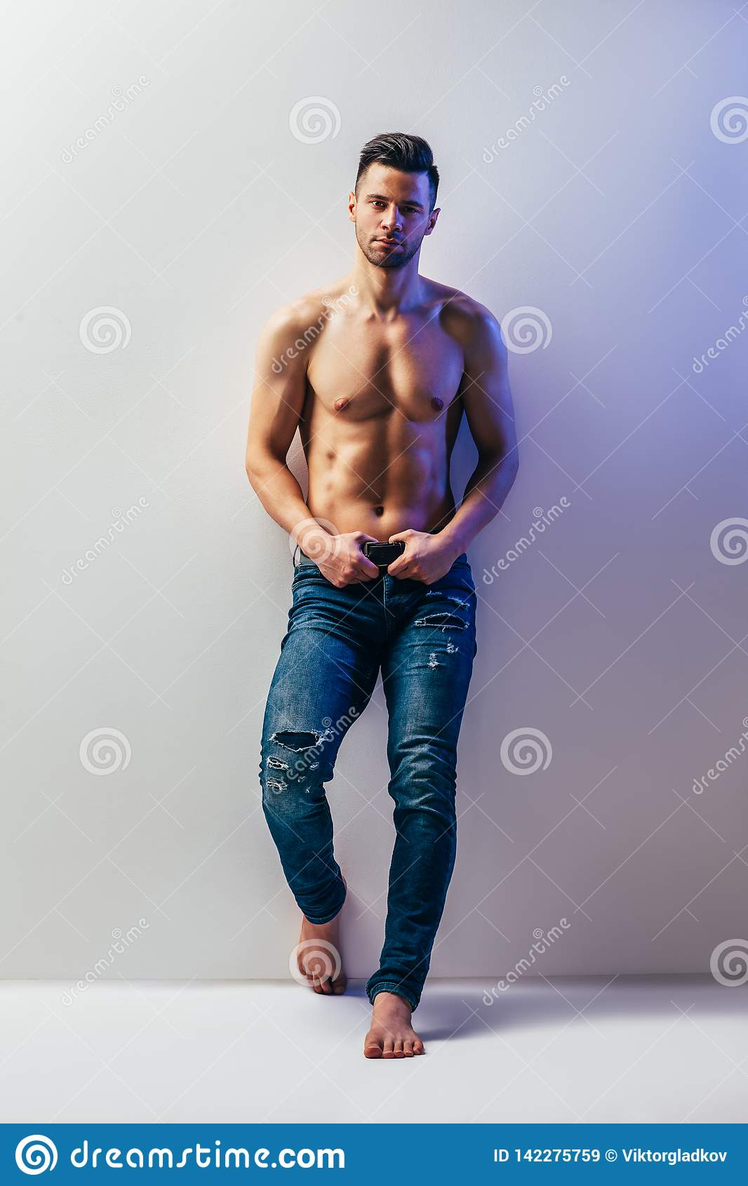 Full length portrait of sexy muscular shirtless man