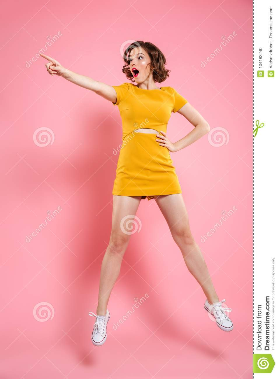 Full length portrait of shocked charming brunette woman with han