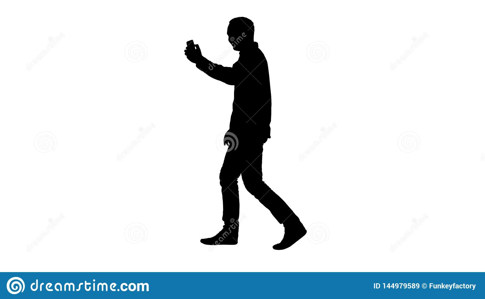 Silhouette Attractive man with short dark hair checking pictures after making selfie.