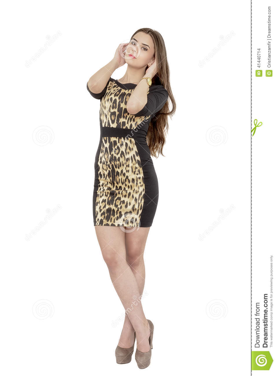 Full length portrait of a smiling fashionable woman