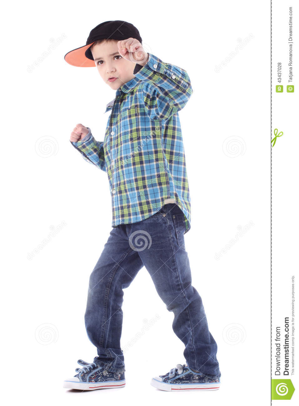 Full length portrait of smiling little boy in jeans and cup