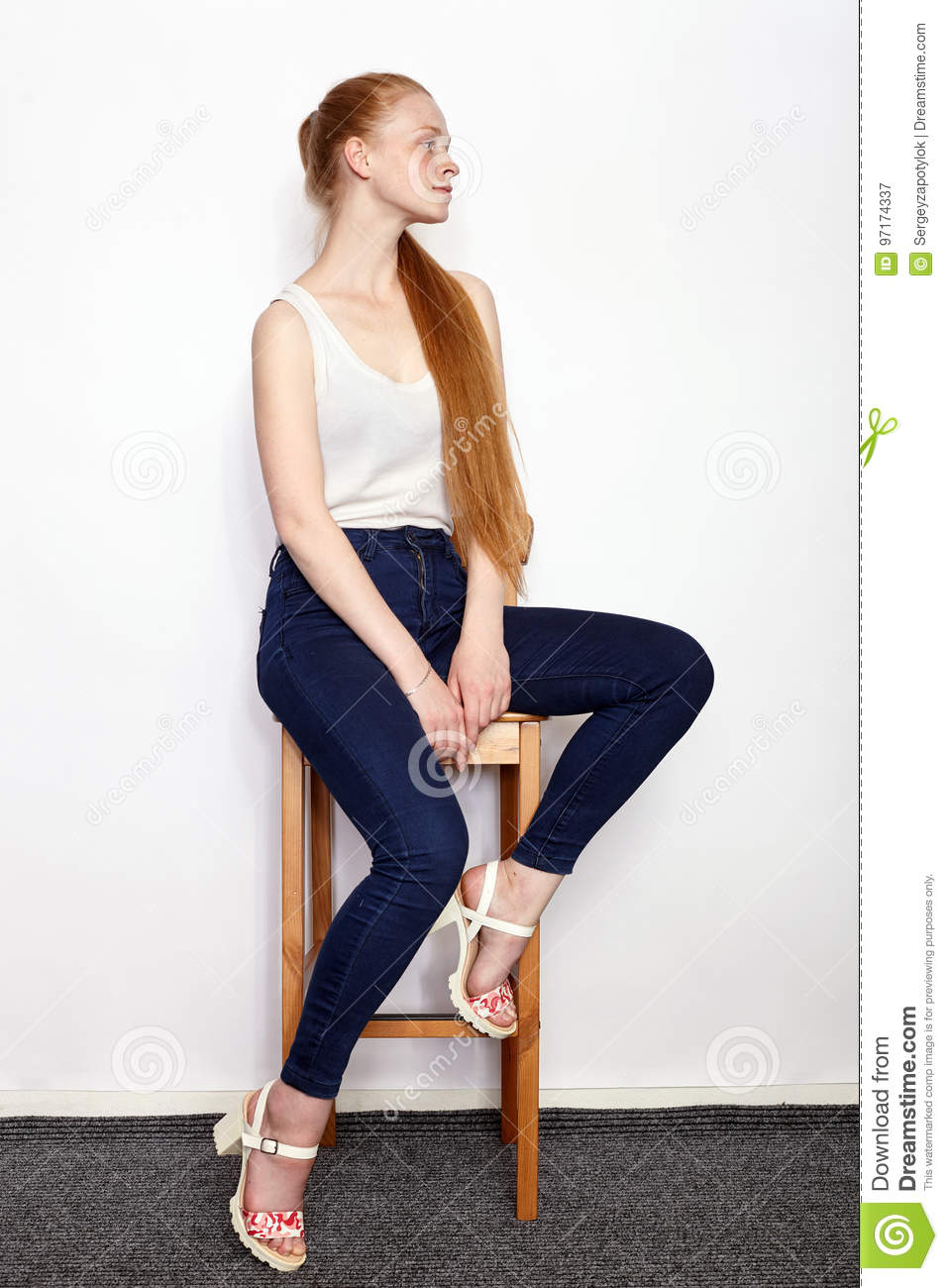 e6e25fd0a6 Full length portrait of young beautiful redhead beginner model woman in white  t-shirt blue