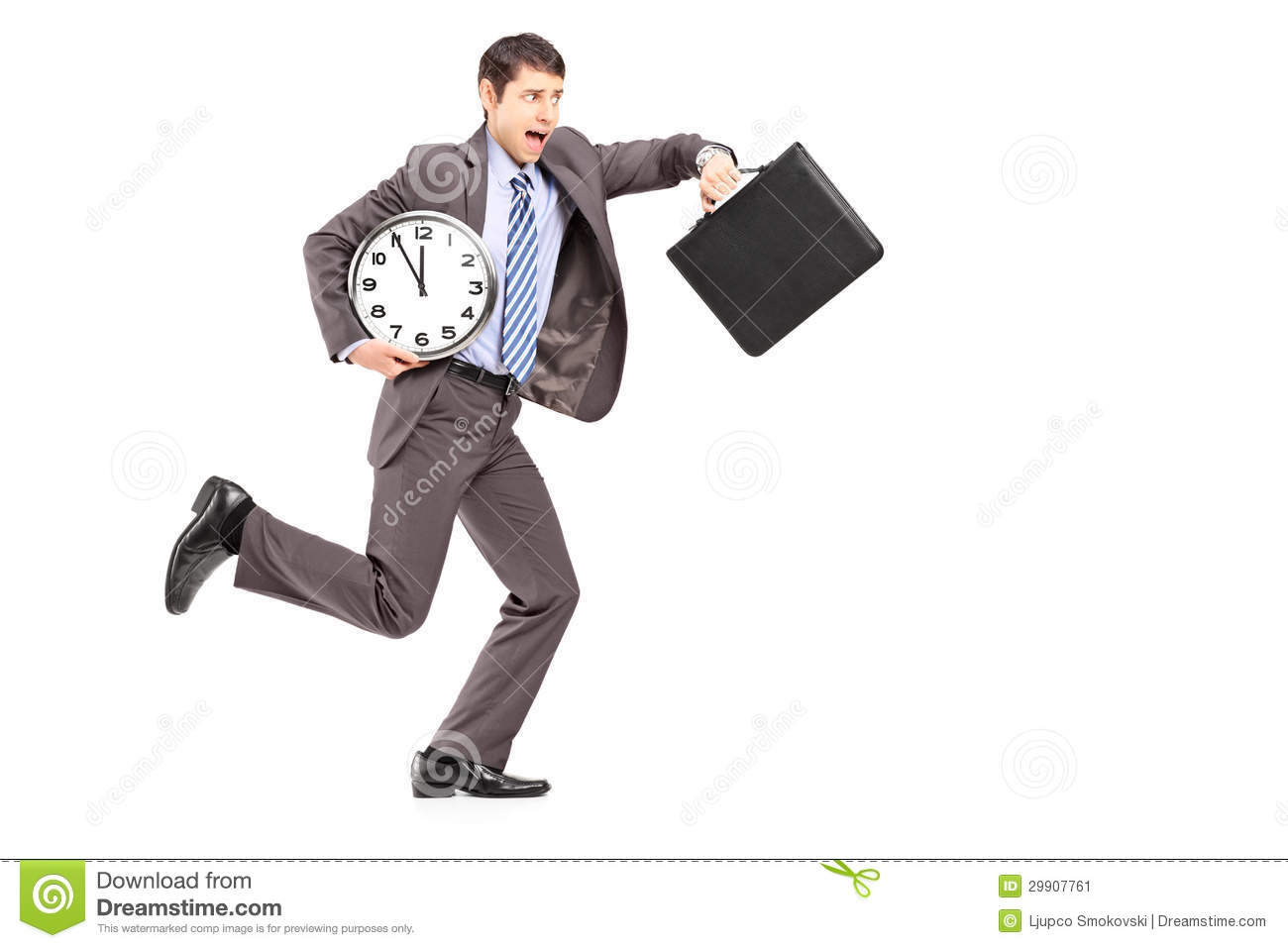 Full length portrait of a young businessman running late