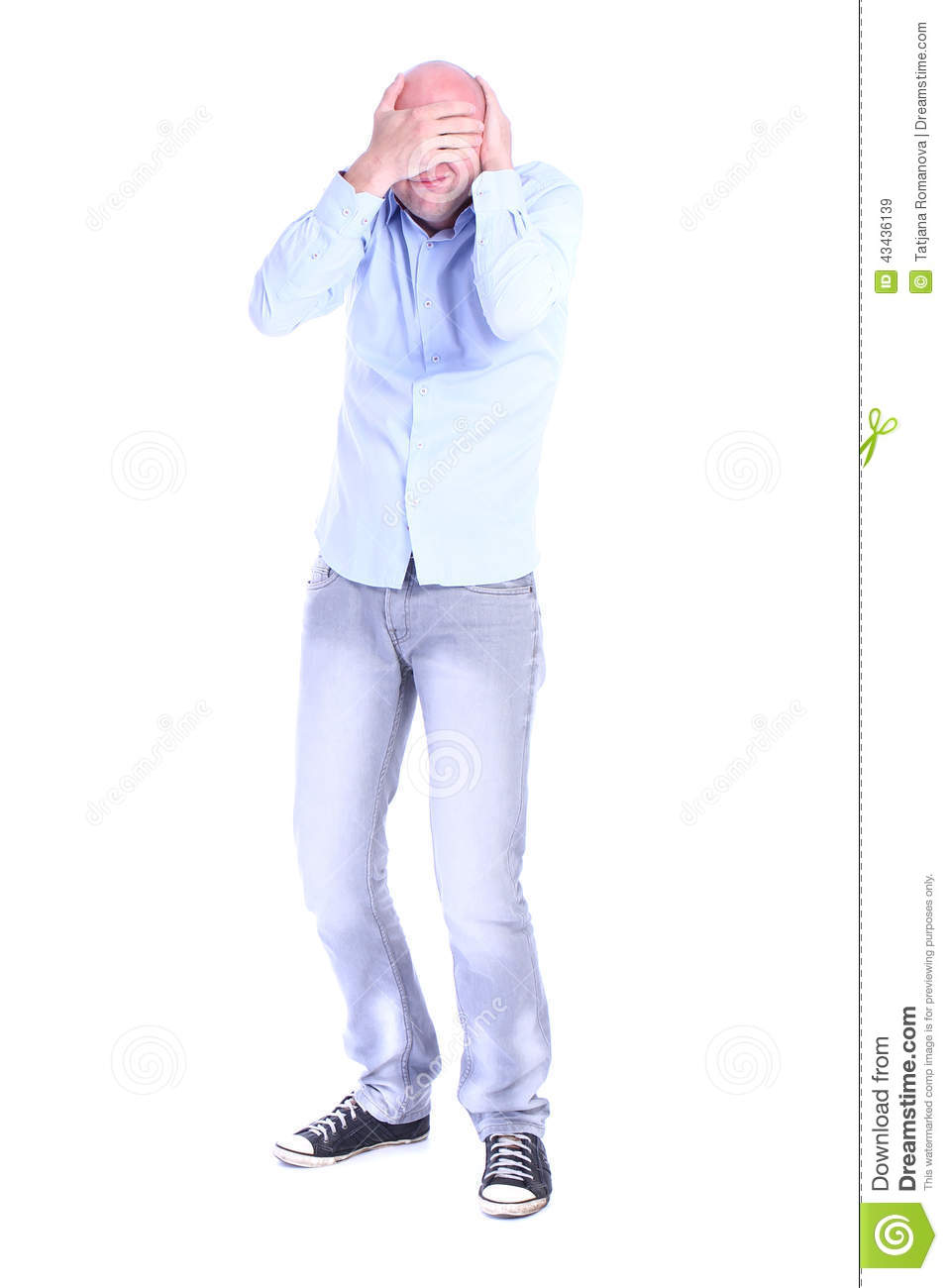 Full length portrait of young desperate man head in his hands