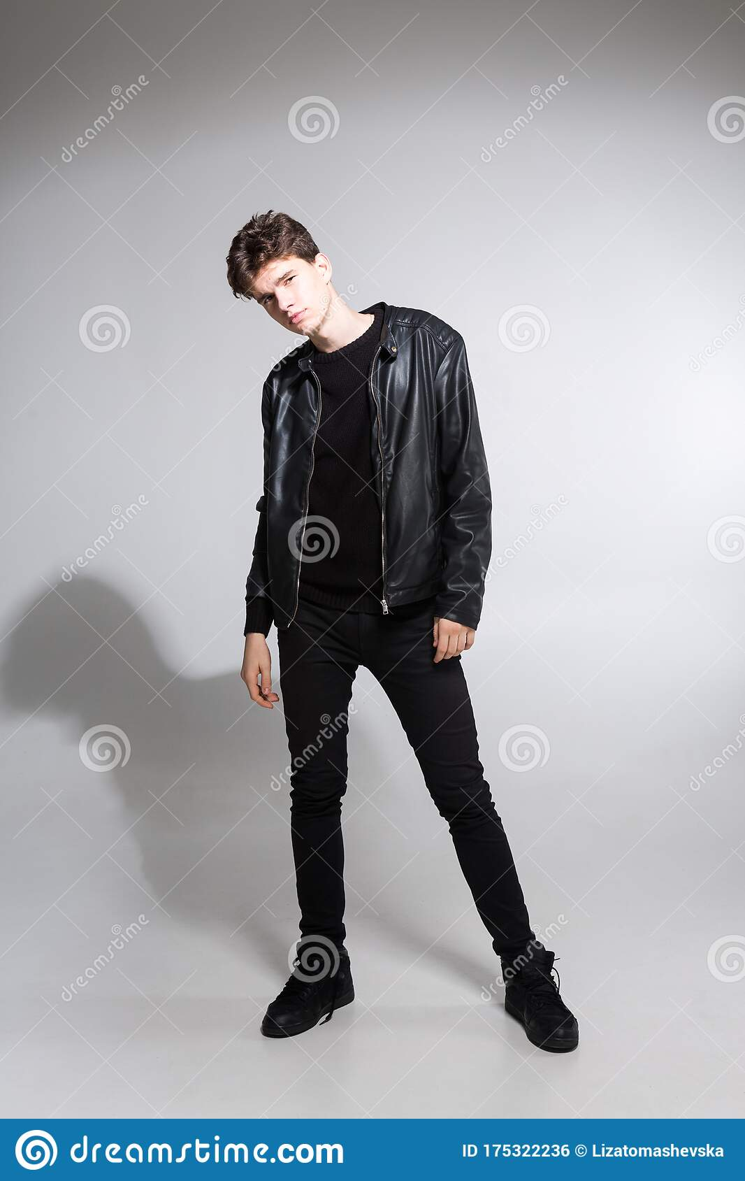 Full Length Portrait Of Young Fit Man In Dark Cloths On The White Background Young Male Fashion Model Posing In Casual Outfit Stock Photo Image Of Clothing Long 175322236