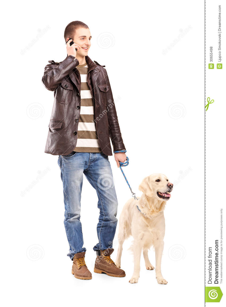 Man Walking Dog : Full length portrait of a young man walking dog and