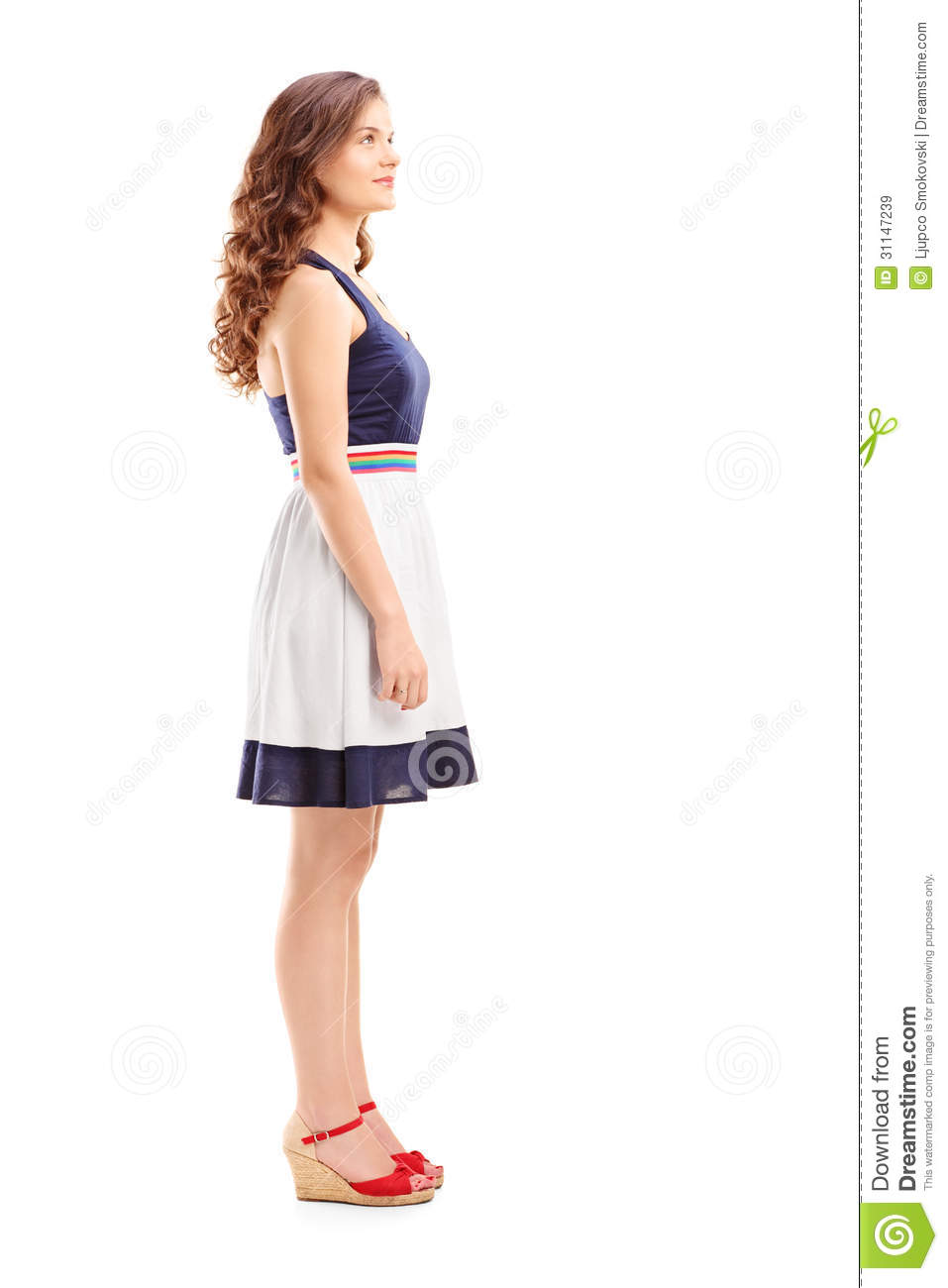 Full Length Portrait Of A Young Woman In Profile Royalty
