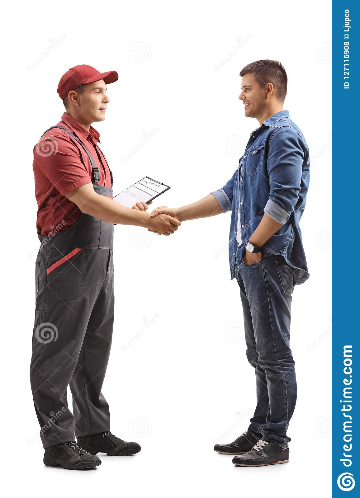 Mover shaking hands with a young man