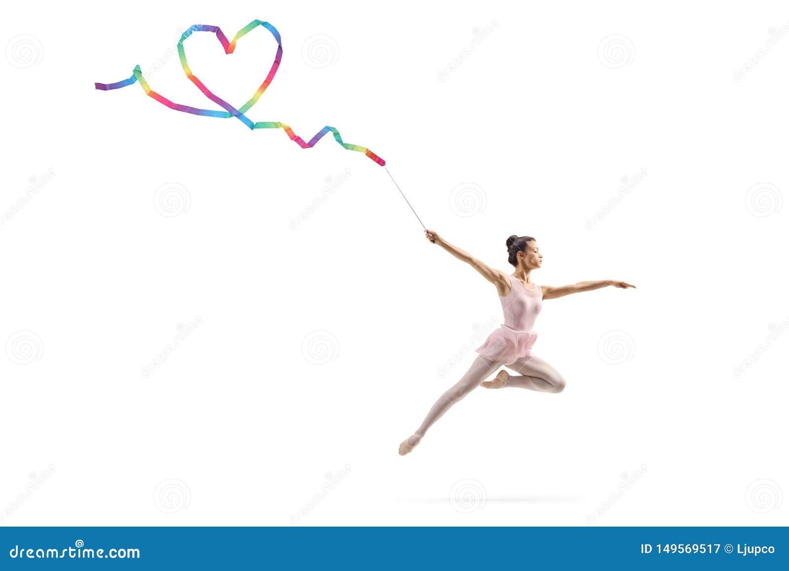 Female gymnast making a heart shape with a ribbon
