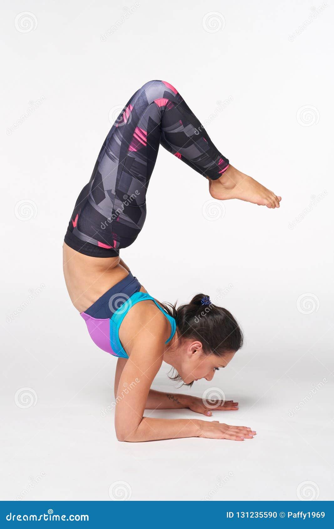 1e14c7c72e61e Full Length Woman Practicing Yoga Vrschikasana, Scorpion Pose Stock ...