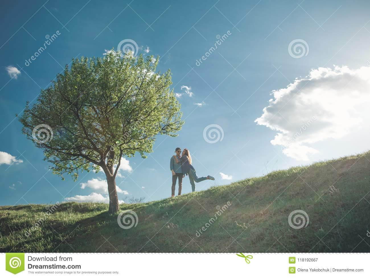 Playful Girl With Young Man By Tree Stock Image Image Of Female