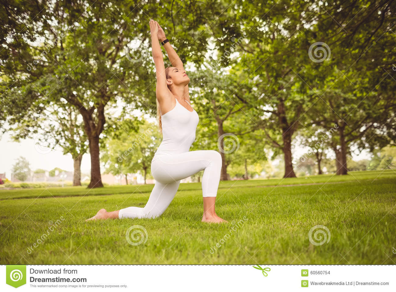 Full Length Of Woman Stretching Body With Hands Raised ...