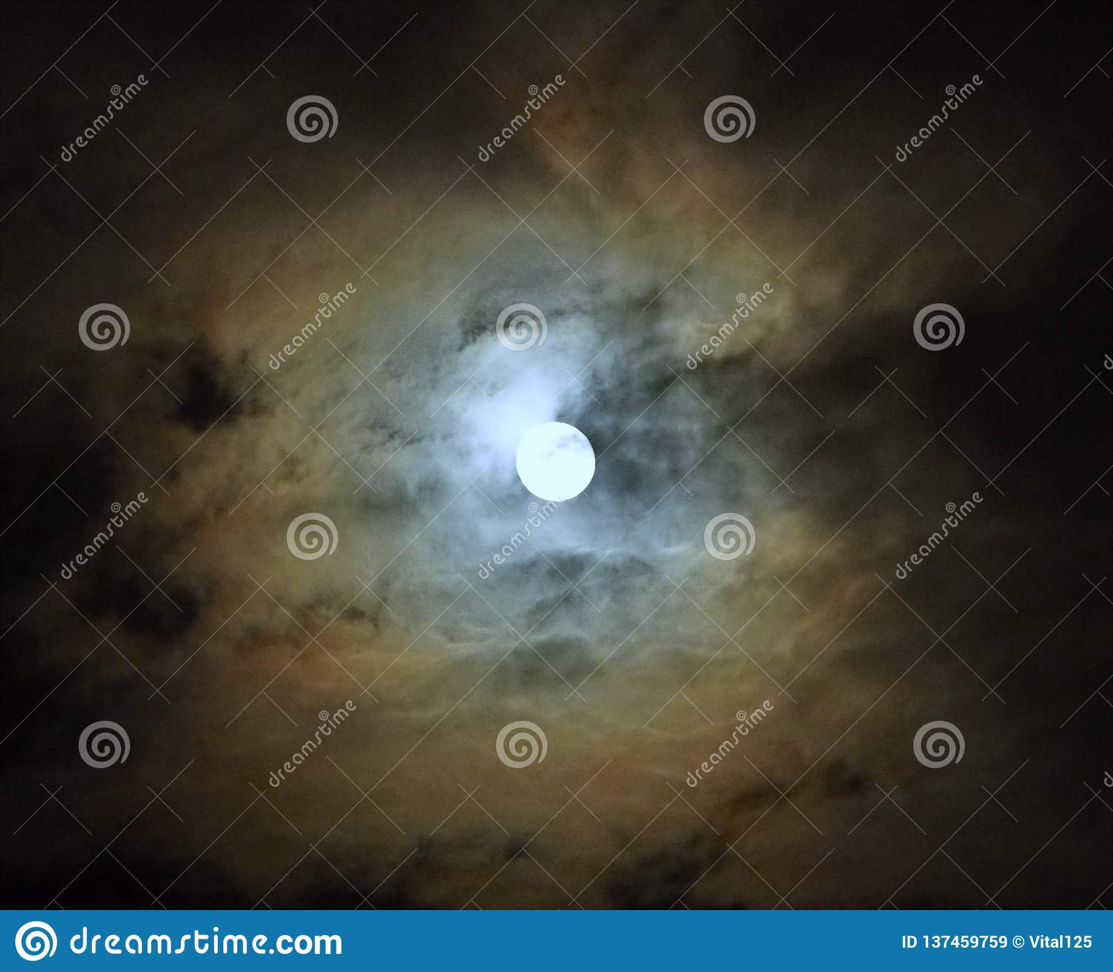 Moon after lunar eclipse and blue clouds