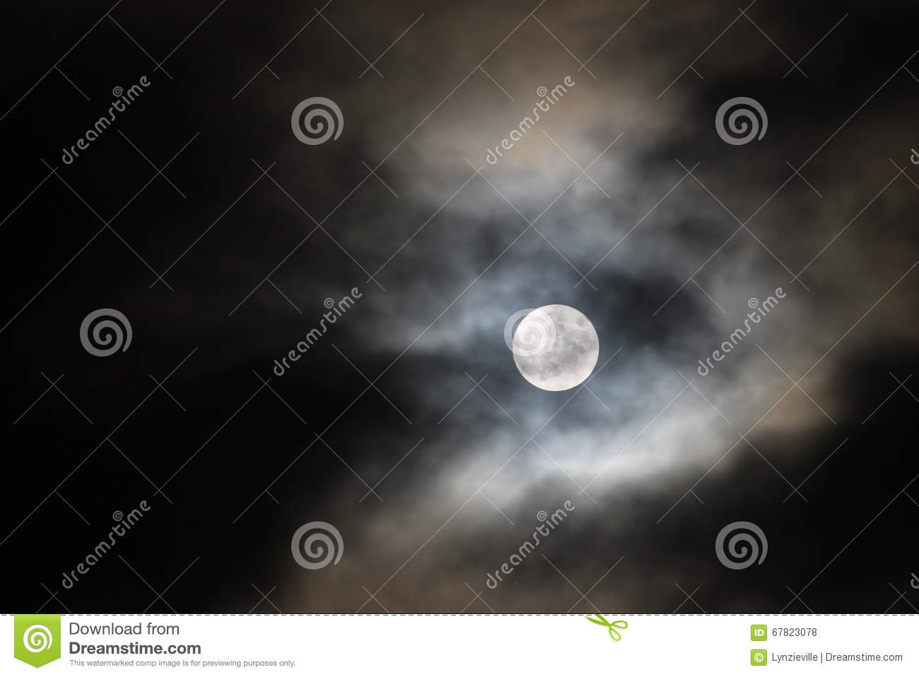 Full moon with dark clouds passing by.
