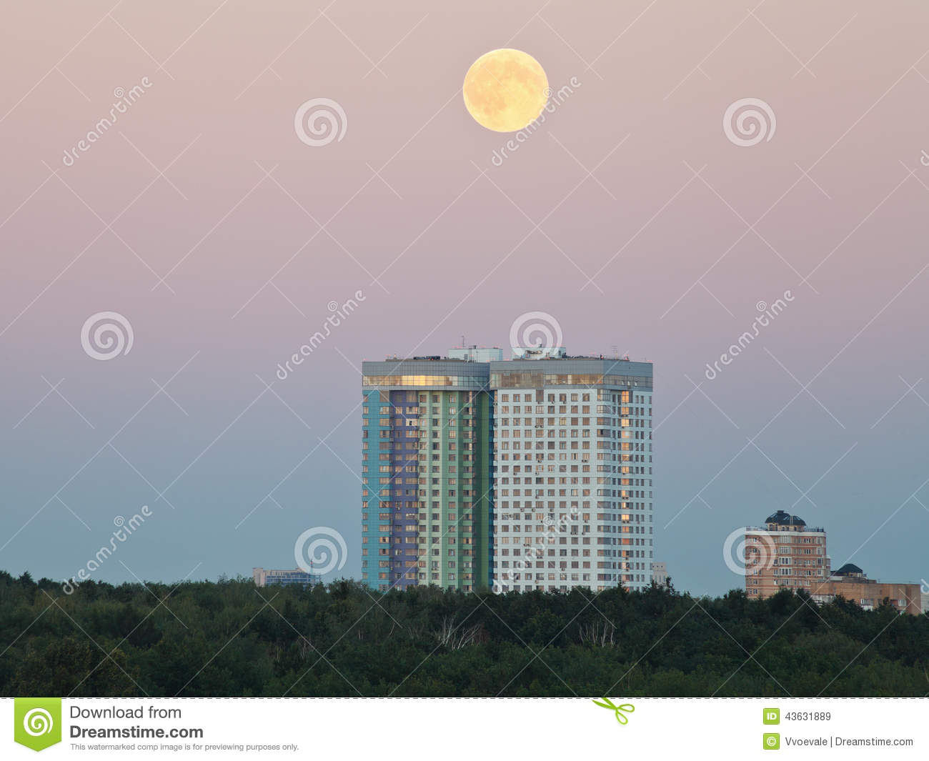 Full Moon In Evening Sky Over Urban Houses Stock Image
