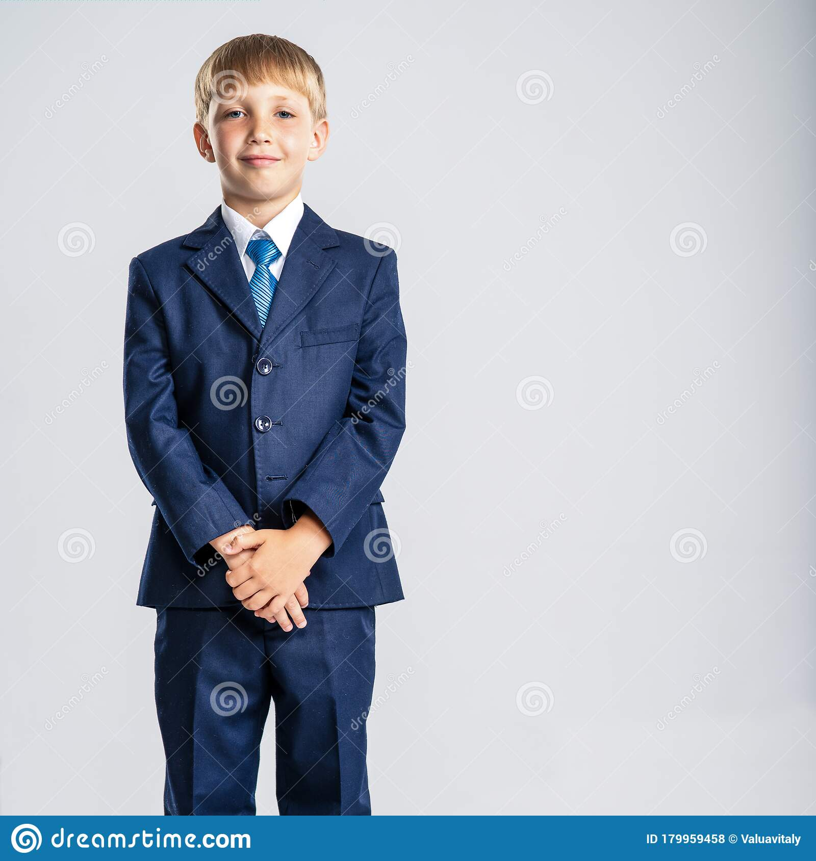 Full Portrait Of White Kid In A Blue Business Suit Posing At Studio Stock Photo Image Of Little People 179959458